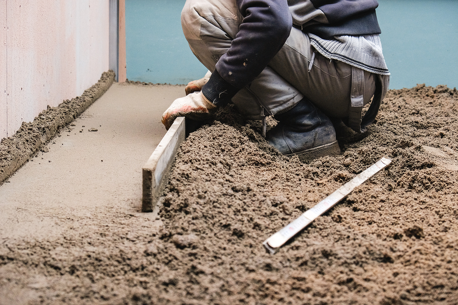 man smoothing the soil